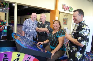 Group of adults playing arcade games